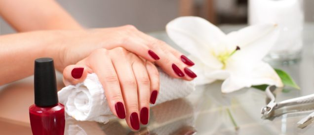 Manicure concept. Hand care at the spa. Beautiful woman